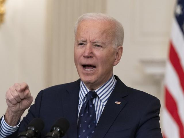 President Joe Biden speaks in the State Dining Room of the White House, Saturday, March 6, 2021. (AP Photo/Alex Brandon)