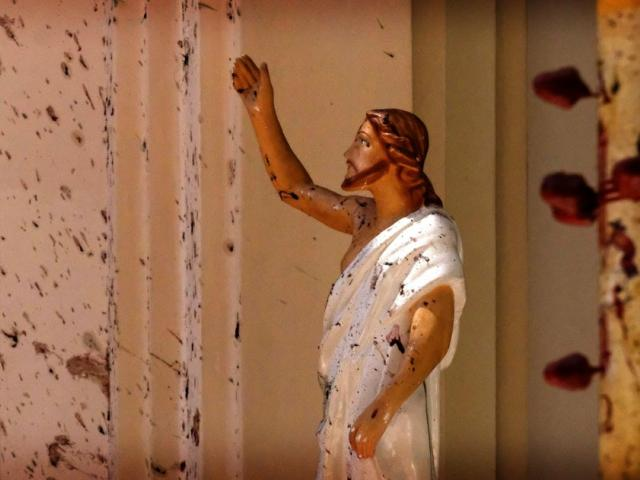 In this April 21, 2019, file photo, blood stains a Jesus Christ statue at the St. Sebastian