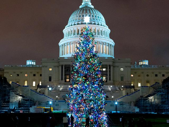 U.S. Capitol Christmas Tree is seen at the U.S. Capitol at night after negotiators sealed a deal for COVID relief Sunday, Dec. 20, 2020, in Washington.