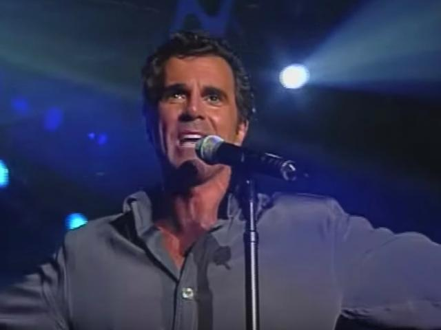 Carman singing in concert