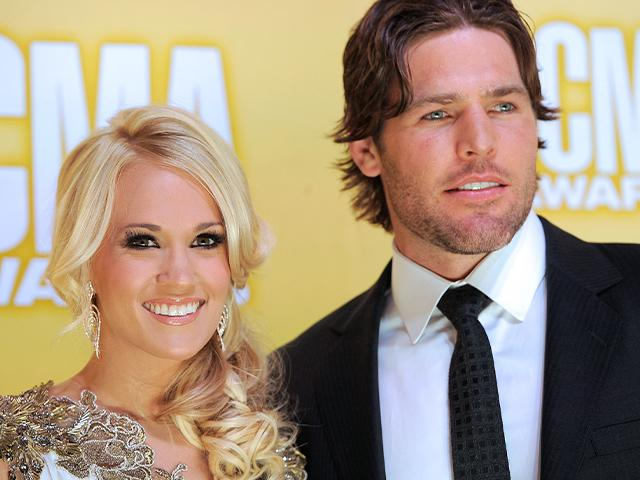 Carrie Underwood and her husband Mike Fisher at the 46th Annual Country Music Awards in 2012, in Nashville, Tenn. (Photo by Chris Pizzello/Invision/AP)