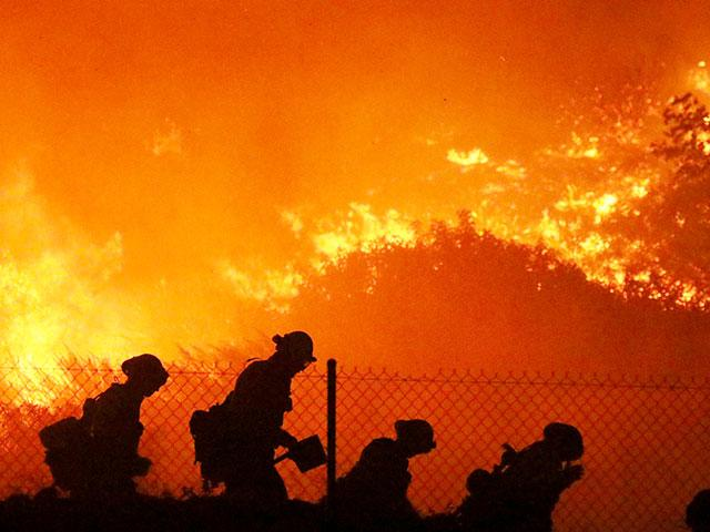 Firefighters battle the Saddleridge fire in Sylmar, Calif., Friday Oct. 11, 2019. (AP Photo/David Swanson)