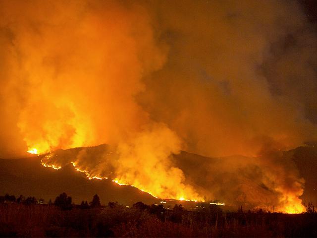 A wildfire burns in Yucaipa, California. (AP Photo/Ringo H.W. Chiu)