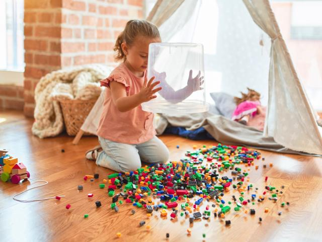 Child playing in messy playroom