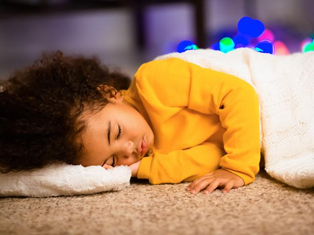 child sleeping on the floor