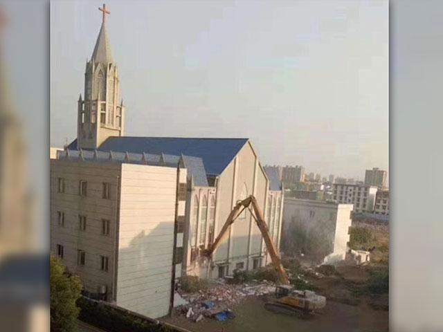 A church building in the Funan, Anhui region of China is torn down on the order of Chinese government officials while the congregation worships inside. (Image credit: China Aid)