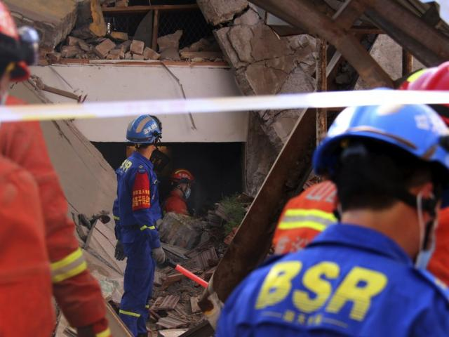 Rescuers search for victims after of the collapse of a two-story restaurant in northern China's Shanxi province. (Chinatopix Via AP)