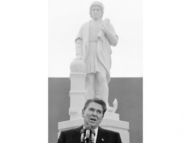 In this, Oct. 9, 1984, file photo, President Ronald Reagan addresses a ceremony in Baltimore, to unveil a statue of Christopher Columbus (AP Photo/Lana Harris, File)