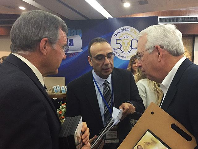 CBN's Chris Mitchell and Michael Little Meet with GPO Director Nitzan Chen, Photo, CBN News