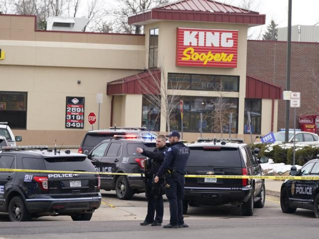 Police work on the scene outside of a King Soopers grocery store where a shooting in Boulder, Colo. (AP Photo/David Zalubowski)