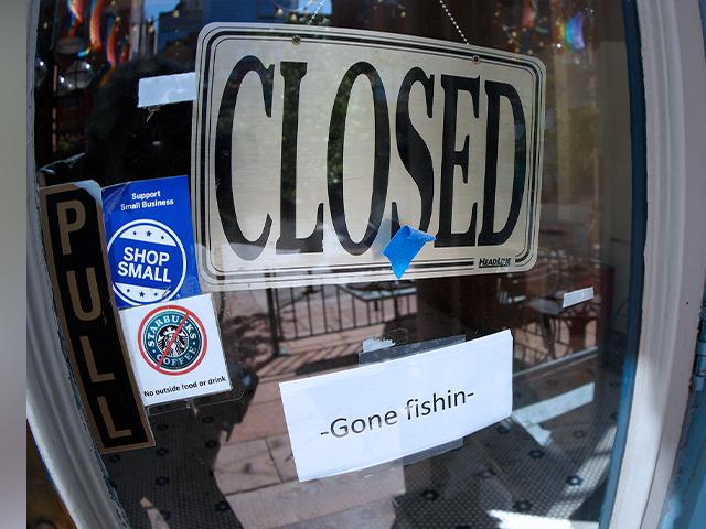 A closed sign hangs in the door of The Market, a long-time restaurant and food store located in Larimer Square, that has closed because of the new coronavirus, Thursday, June 18, 2020, in downtown Denver. (AP Photo/David Zalubowski)