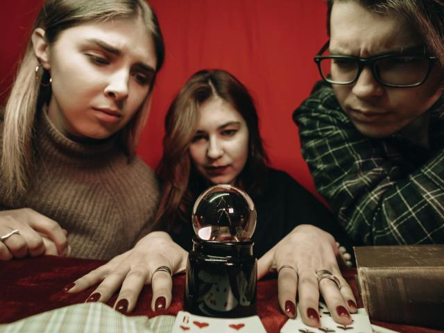 Teens with crystal ball psychic reading