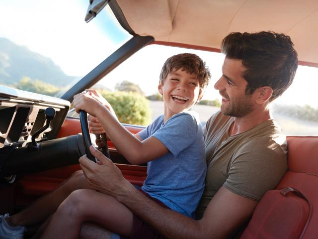 Dad fake driving with young son