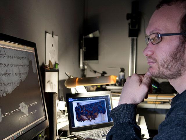 Oren Ableman examines ink traces, Photo, IAA, Shai Halevi