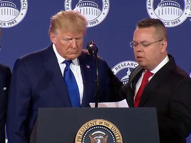 Pastor Andrew Brunson prays for President Donald Trump at the Values Voters Summit (Photo CBN News)