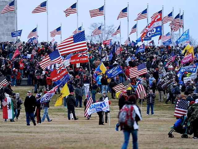 Trump supporters gather on the Washington Monument grounds in advance of a rally Wednesday, Jan. 6, in Washington.