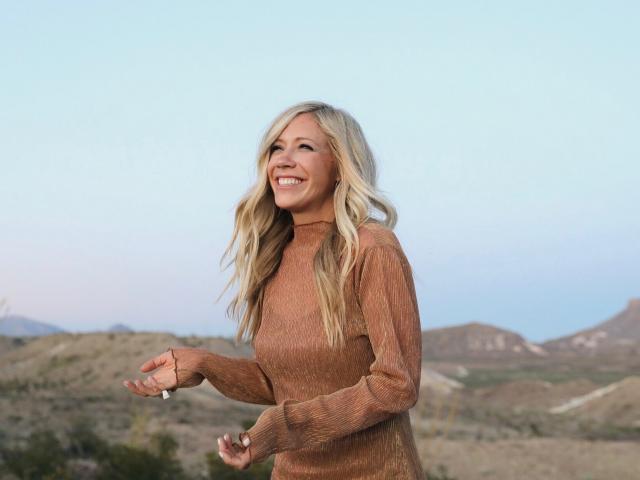 Ellie Holcomb standing in desert