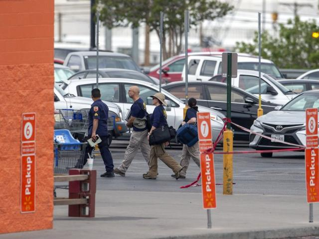 FBI agents arrive to the Walmart store in the aftermath of a mass shooting in El Paso, Texas, Sunday, Aug. 4, 2019 (AP Photo/Andres Leighton)