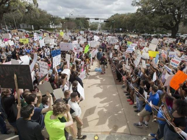 Students gather on the steps of the old Florida capitol protesting gun violence in Tallahassee, Fla.