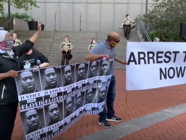 Minneapolis protesters rally following the death of black man in police custody