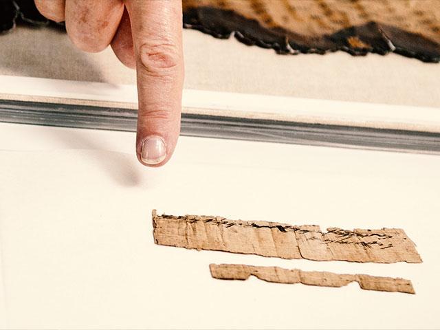 Discovered small document written on papyrus contains two lines of Hebrew script