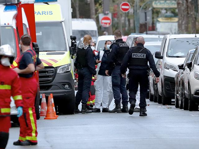 French police and rescue workers gather at the scene of a knife attack near the former offices of satirical newspaper Charlie Hebdo, Sept. 25, 2020 in Paris. Islamic extremists attacked those offices in 2015, killing 12 people. (AP Photo/Thibault Camus)