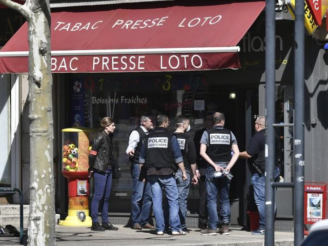 Police gather after a man wielding a knife attacked residents venturing out to shop in the town under lockdown, Saturday April 4, 2020 in southern France (AP Photo)