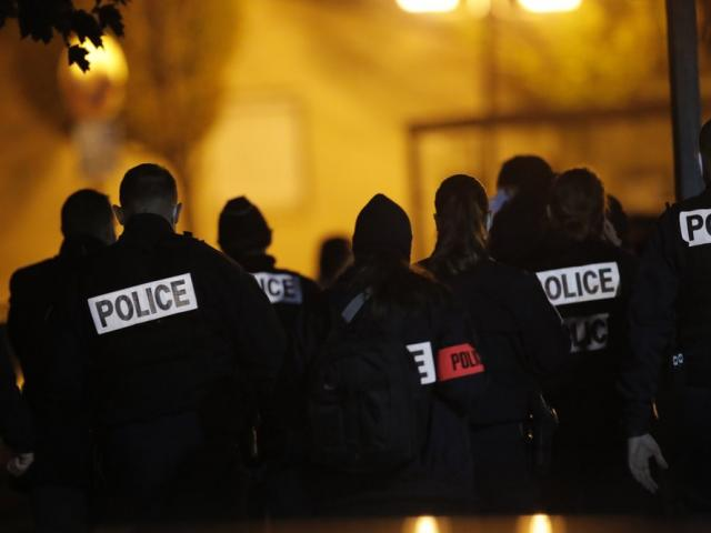 French police officers gather after history teacher was beheaded in Conflans-Saint-Honorine, north of Paris (AP Photo/Michel Euler)