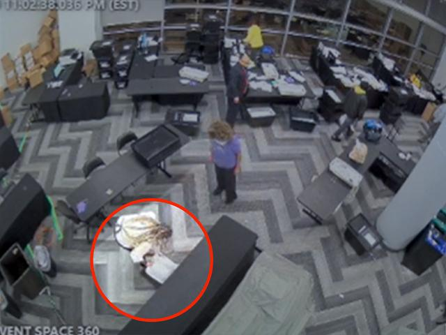 Surveillance video from the State Farm Arena in Fulton, GA shows suitcases of ballots pulled from hiding late at night (Image: Screen Capture)