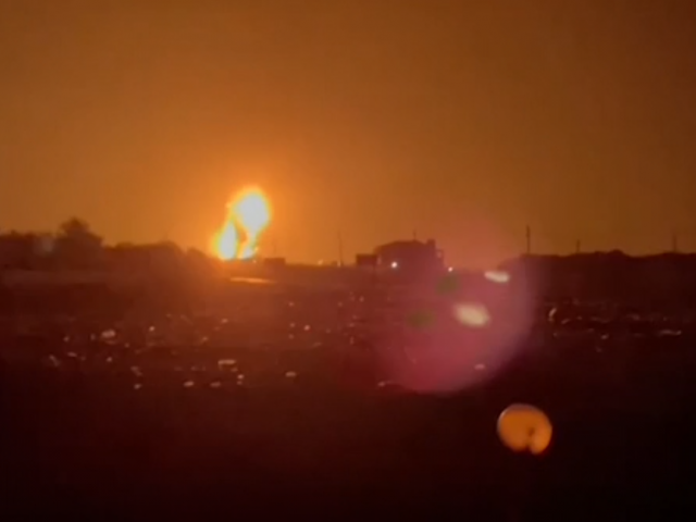 Wide of explosion lighting up the night sky as Israel strikes Hamas targets in Gaza. 13 September 2021. Screesnshot of AP footage.