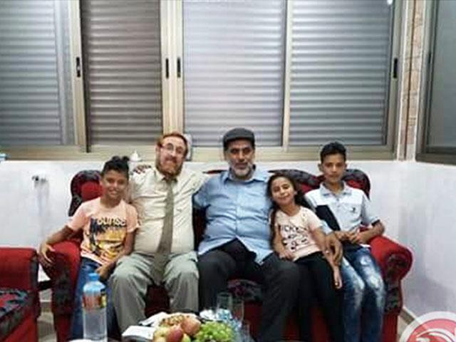 Hebron resident Mohammad Jabir Hosts Israeli MK Yehuda Glick, Photo, Facebook