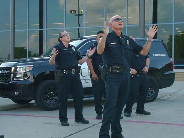 "Officers of the Crandall, Texas Police Department appear in their lip-sync version of the popular Christian song ""God's Not Dead."" Photo courtesy:  Crandall Police Department/Facebook"