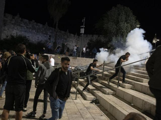 Palestinian worshippers clashed with Israeli police late Friday at the holy site sacred to Muslims and Jews (AP Photo/Maya Alleruzzo)