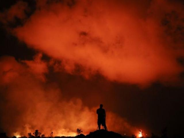Peter Vance, 24, photographs lava erupting in the Leilani Estates subdivision near Pahoa, Hawaii Friday, May 18, 2018. AP Photo.