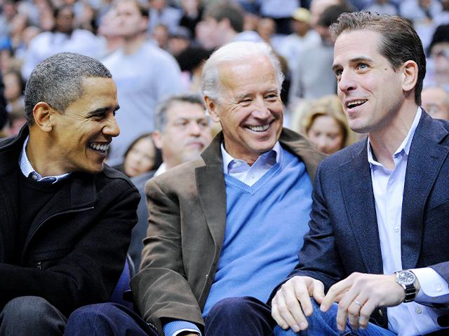 This Jan. 30, 2010 photo shows Hunter Biden talking with his father Vice President Joe Biden and President Barack Obama during a college basketball game in Washington. (AP Photo/Nick Wass, File)