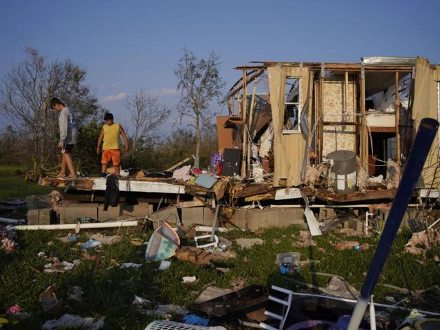 Remnants of a family's home destroyed by Hurricane Ida, Saturday, Sept. 4, 2021, in Dulac, La. (AP Photo/John Locher)