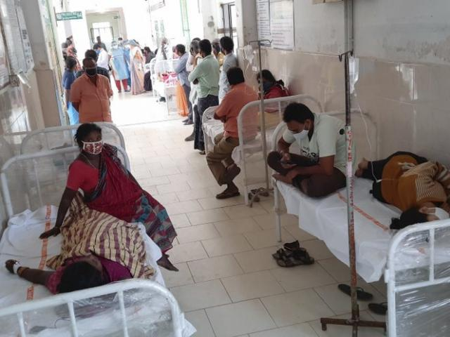 Patients and bystanders are seen at the hospital in Eluru, Andhra Pradesh state, India, Sunday, Dec.6, 2020. (AP Photo)