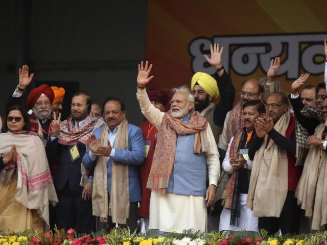 Indian Prime Minister Narendra Modi, center, waves to supporters at a rally of his Hindu nationalist Bharatiya Janata Party in New Delhi, India, Sunday, Dec. 22, 2019. (AP Photo)
