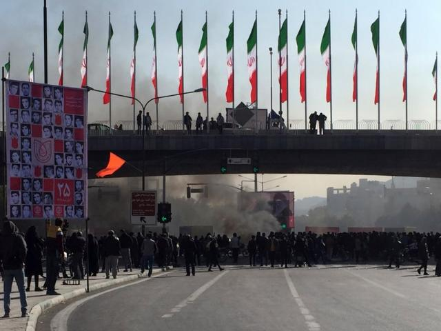 Smoke rises during a protest after authorities raised gasoline prices, in the central city of Isfahan, Iran, Saturday, Nov. 16, 2019. (AP Photo)