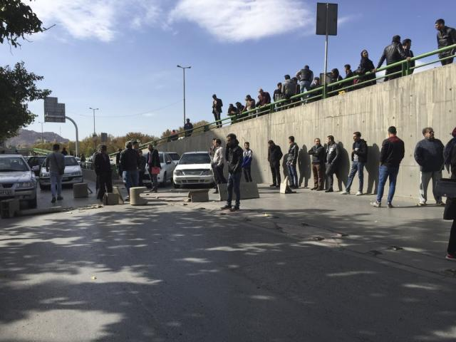 Demonstrators block a street during a protest after authorities raised gasoline prices, in the central city of Isfahan, Iran, Saturday, Nov. 16, 2019. (AP Photo)