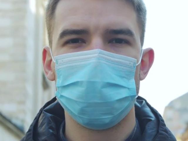 Close up of young man wearing mask