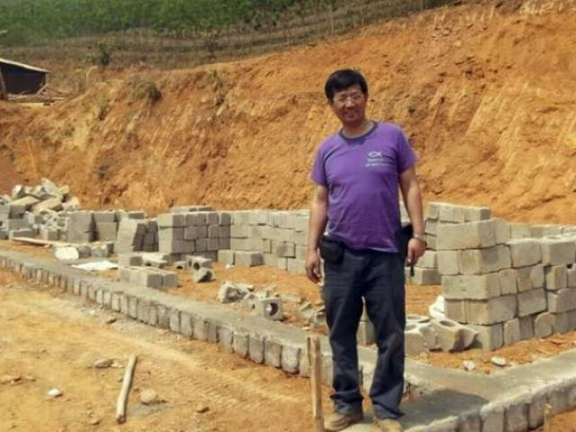 Pastor John Cao breaks a ground on a new school in Wa State, Myanmar. The prominent Chinese pastor was detained by Chinese authorities in March 2017(AP Photo)