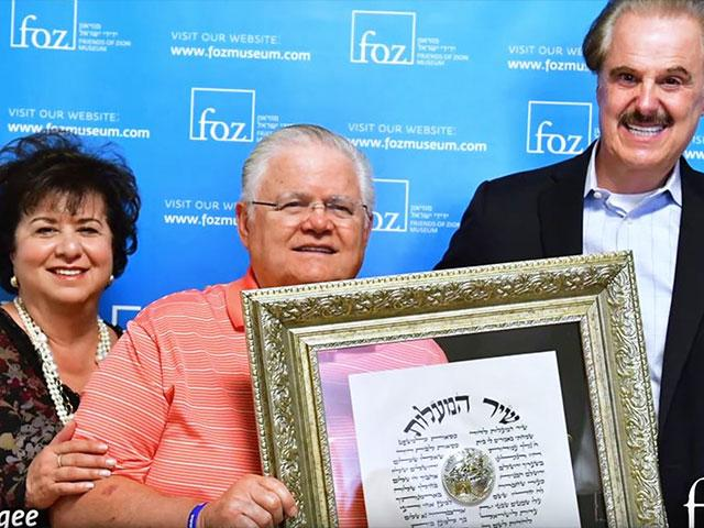 Pastor John Haage and his Wife, Diana, Receive the FOZ Friendship Medallion in Jerusalem from Dr. Mike Evans
