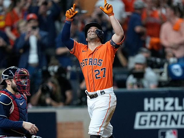 Houston Astros' Jose Altuve celebrates after a home run during the seventh inning in Game 2 of baseball's World Series between the Houston Astros and the Atlanta Braves Wednesday, Oct. 27, 2021, in Houston. (AP Photo/David J. Phillip)