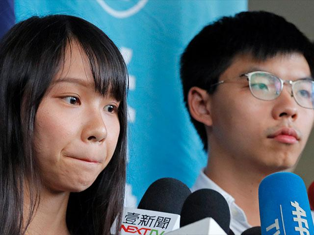 Pro-democracy activists Joshua Wong and Agnes Chow