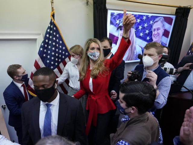 U.S. Senate Sen. Kelly Loeffler gestures to supporters after speaking at a campaign rally. (AP Photo/John Bazemore, File)