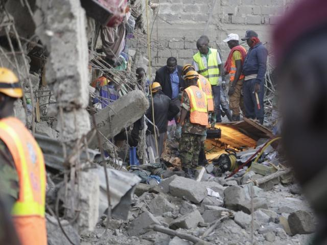 People and rescue workers attend the scene of a building that collapsed in Tasia Embakasi, an east neighbourhood of Nairobi, Kenya on Friday Dec. 6, 2019. (AP Photo)