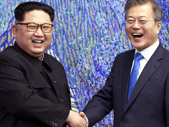North Korean leader Kim Jong Un Shakes Hands with South Korean President Moon Jae-in, Photo, AP