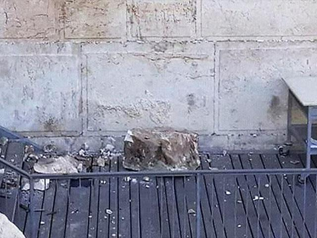 220-pound rock that fell in the 'egalitarian' section at the southern end of the Western Wall, Photo, AP