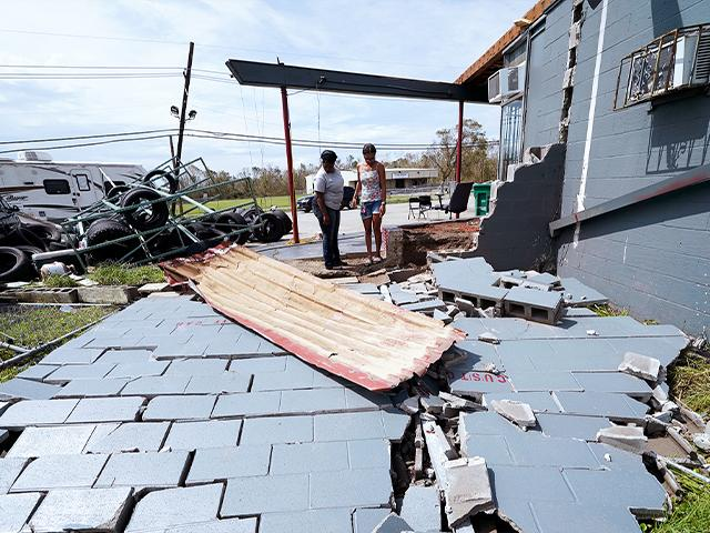 Damage to a business in Lake Charles, La., in the aftermath of Hurricane Laura, Sunday, Aug. 30, 2020.(AP Photo/Gerald Herbert)